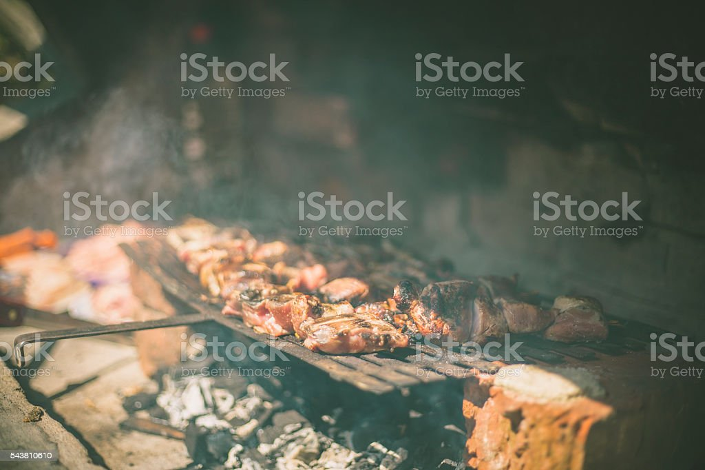 Barbecue grill with various kinds of meat stock photo