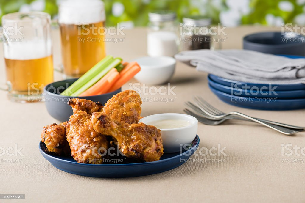 Barbecue hot chicken wings with beers at pub garden stock photo