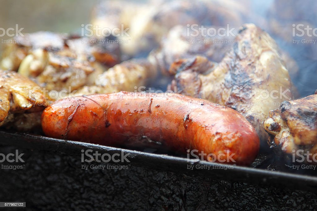 Barbecue. Meat on the grill. stock photo