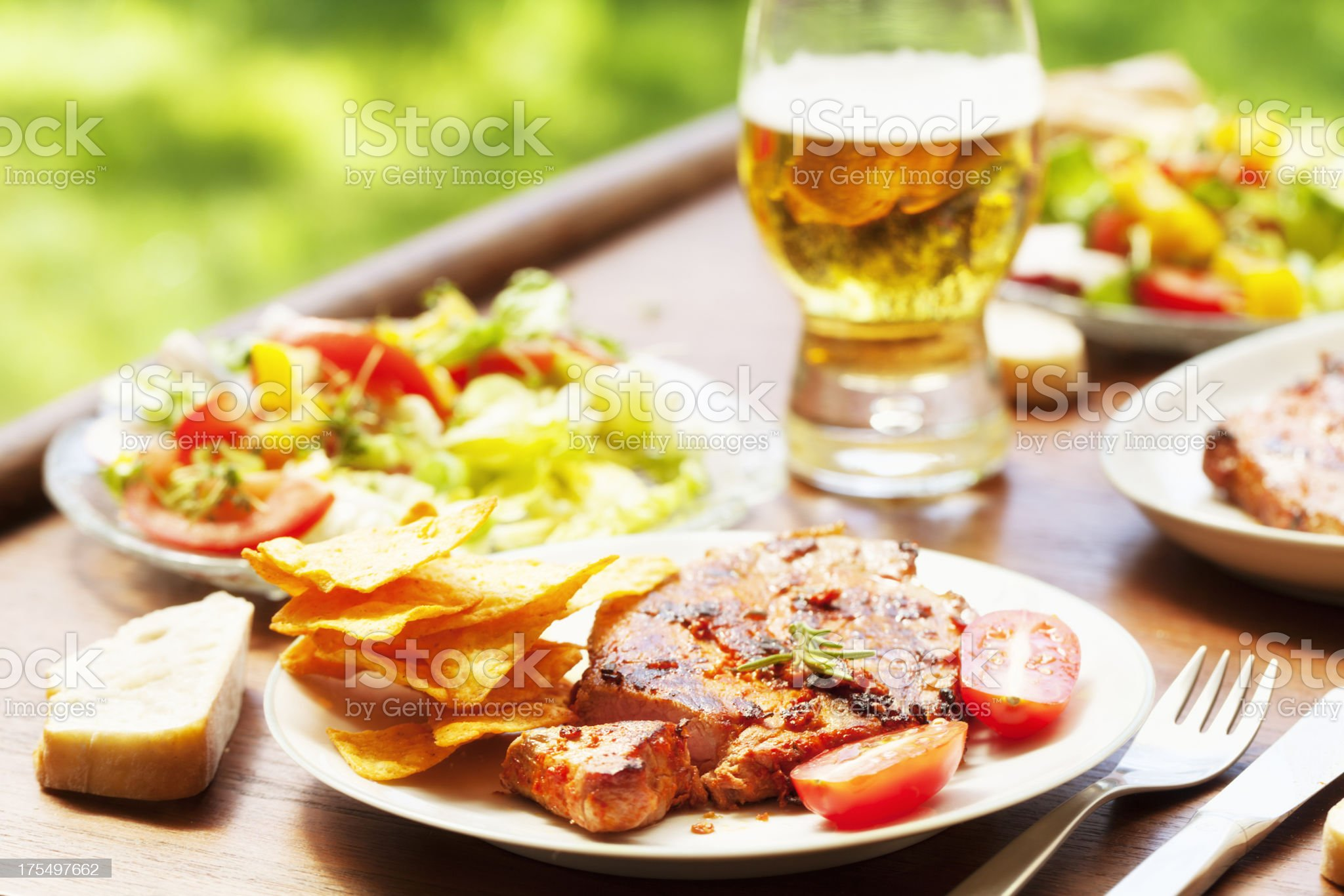 barbecue pork loin chop salad and beer royalty-free stock photo