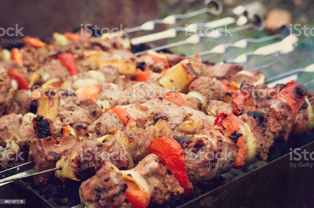 barbecue pork on a charcoal grill stock photo