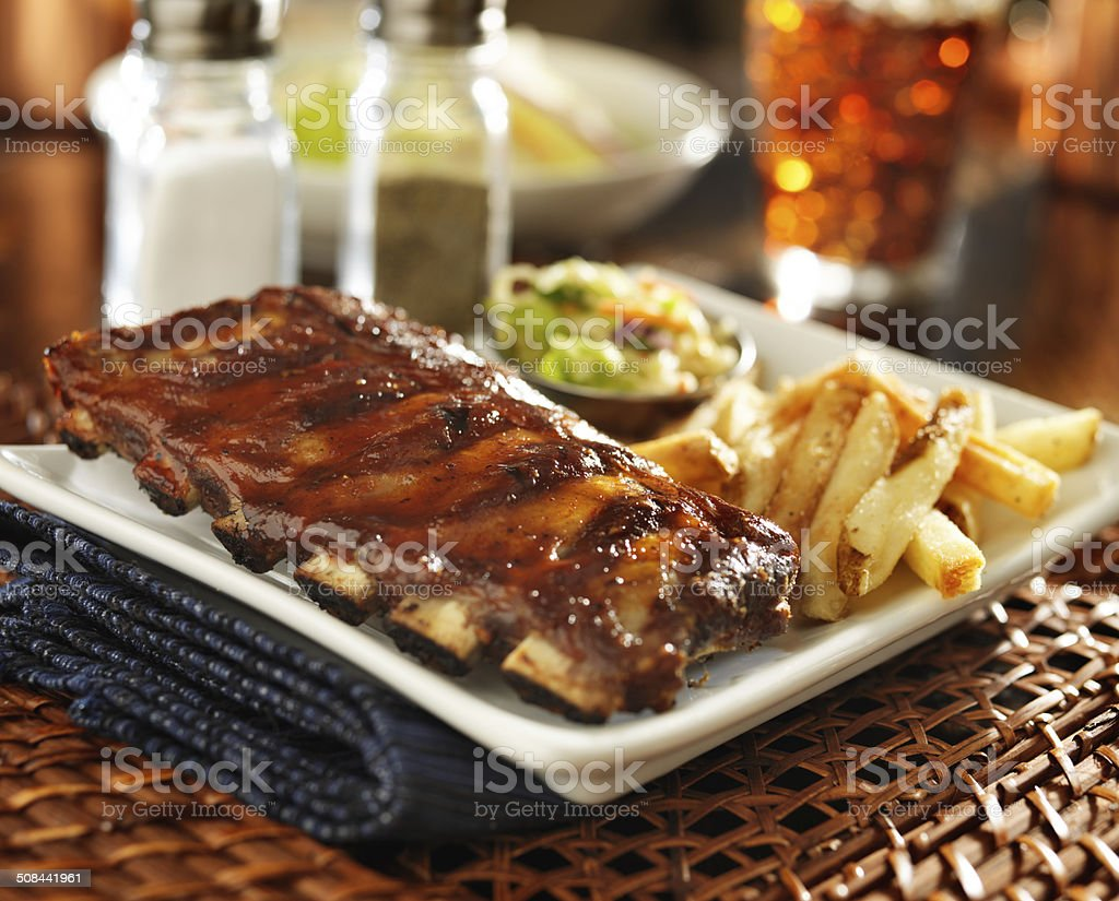 barbecue rib meal with cole slaw and french fries stock photo