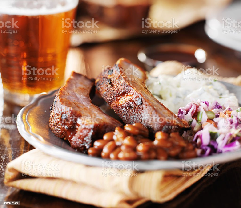 barbecue rib meal with fixings stock photo
