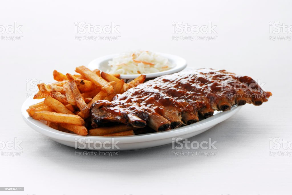 Barbecue ribs and fries stock photo