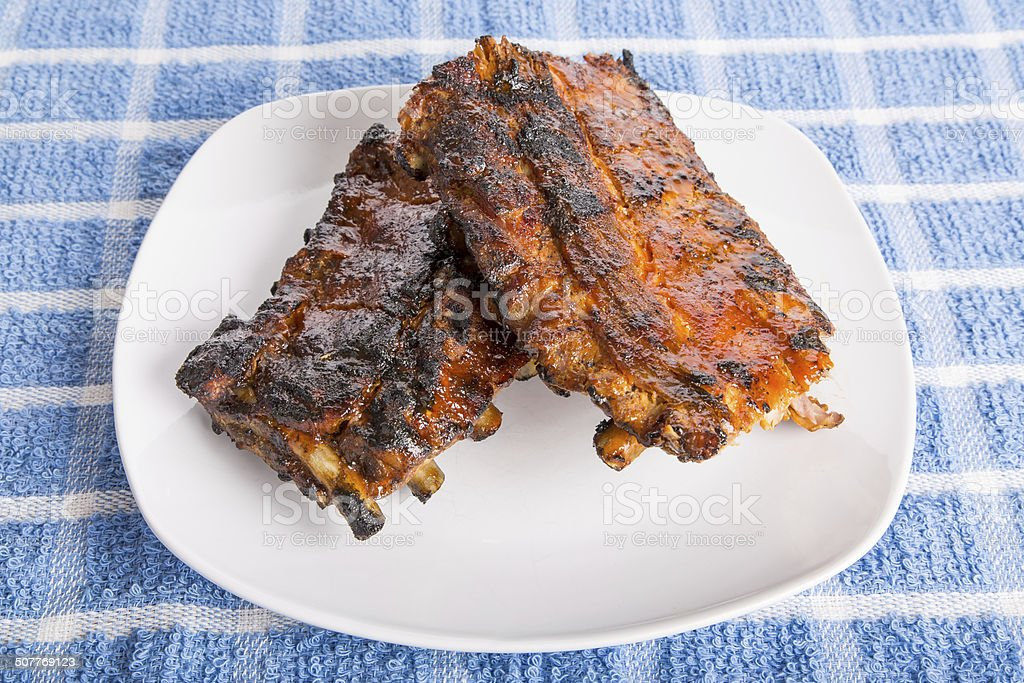 Barbecue Ribs on White Plate stock photo