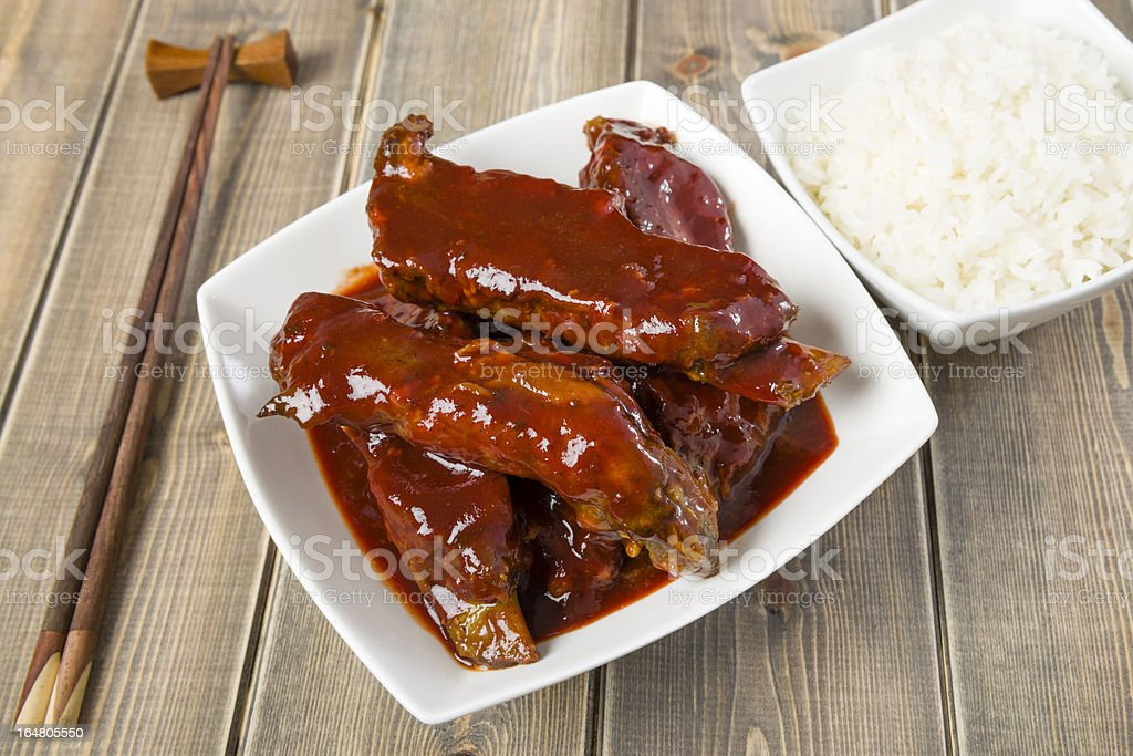 Barbecue sauce covered meat in a square white dish royalty-free stock photo