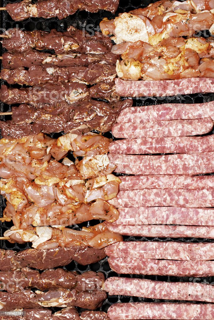 Barbecue skewers on the grill royalty-free stock photo