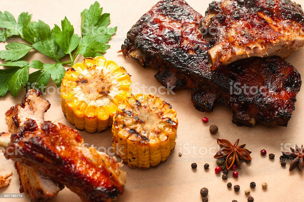 Barbecue spare ribs with corn on wood stock photo