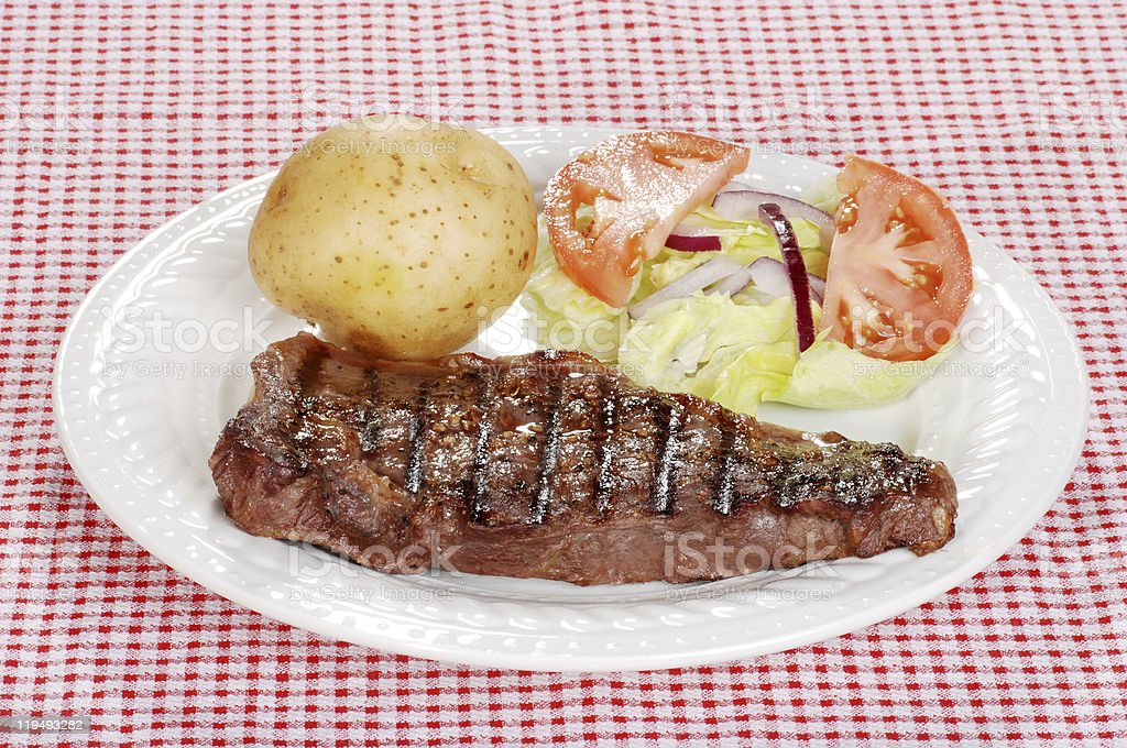barbecue steak with salad and baked potato royalty-free stock photo