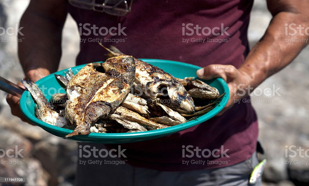 barbecued aegean sea fish in Turkey stock photo