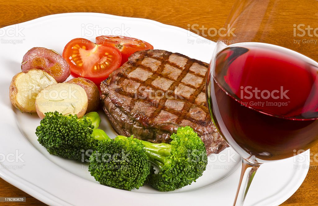 Barbecued Beef Steak and a Glass of Red Wine royalty-free stock photo