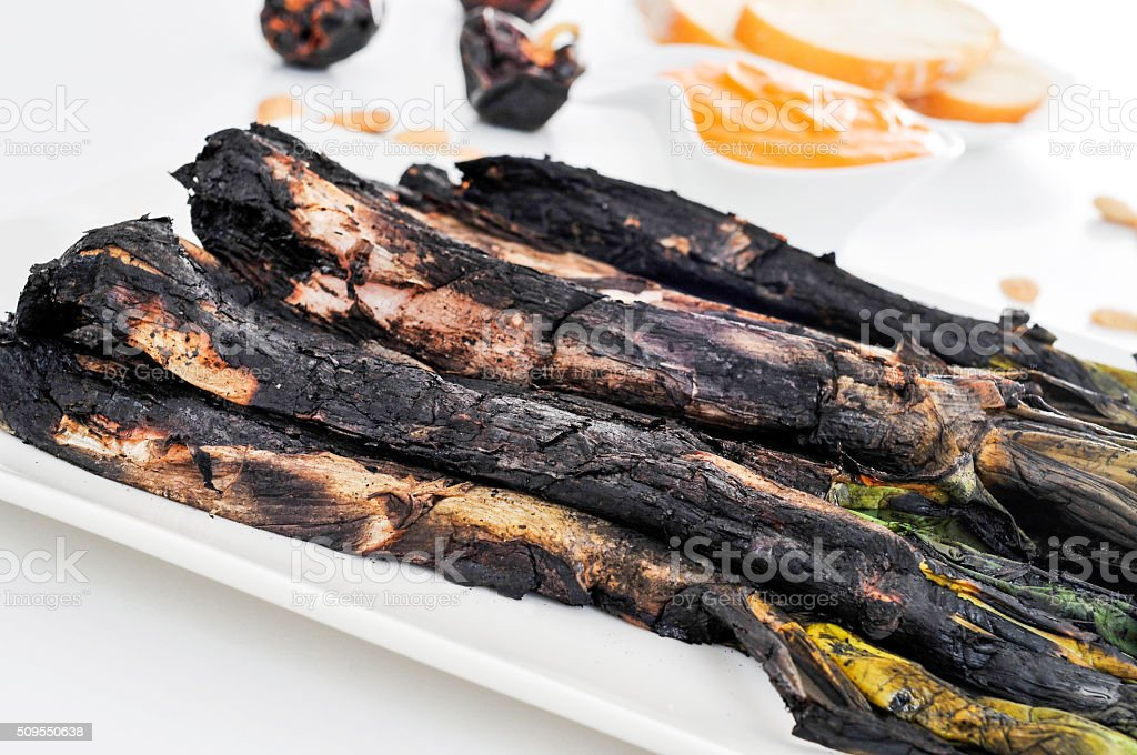 barbecued calcots, sweet onions stock photo