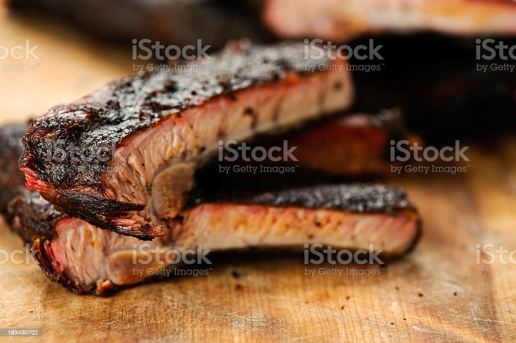 Barbecued pork ribs on a wooden table top stock photo