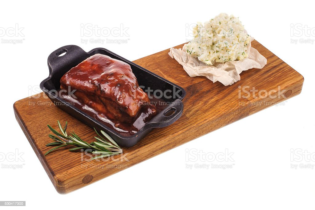 barbecued pork spare ribs on wood boad isolated stock photo