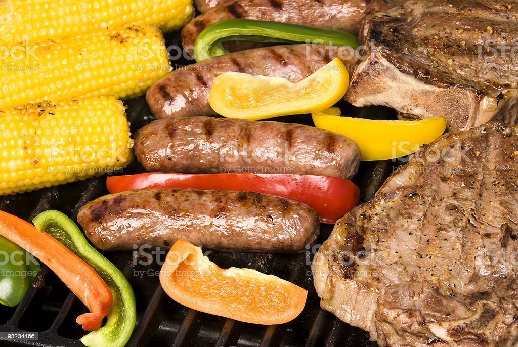 Barbecued steak, bratwurst and corn on the cob royalty-free stock photo