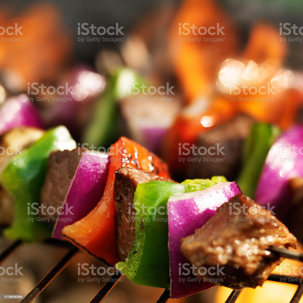 barbecuing beef shish kabobs stock photo