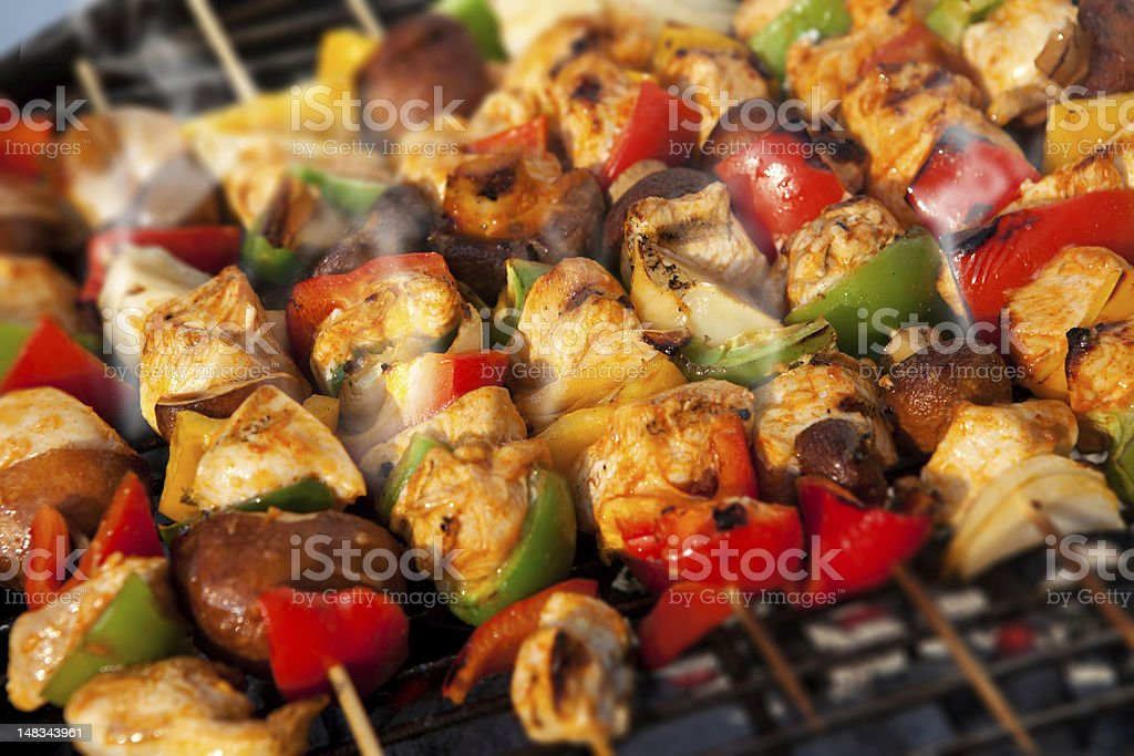 BBQ barbecuing skewers kebab stock photo