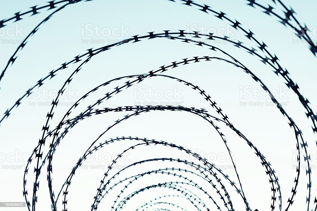 Barbed metal fence stock photo