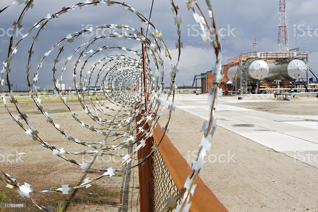Barbed oil stock photo