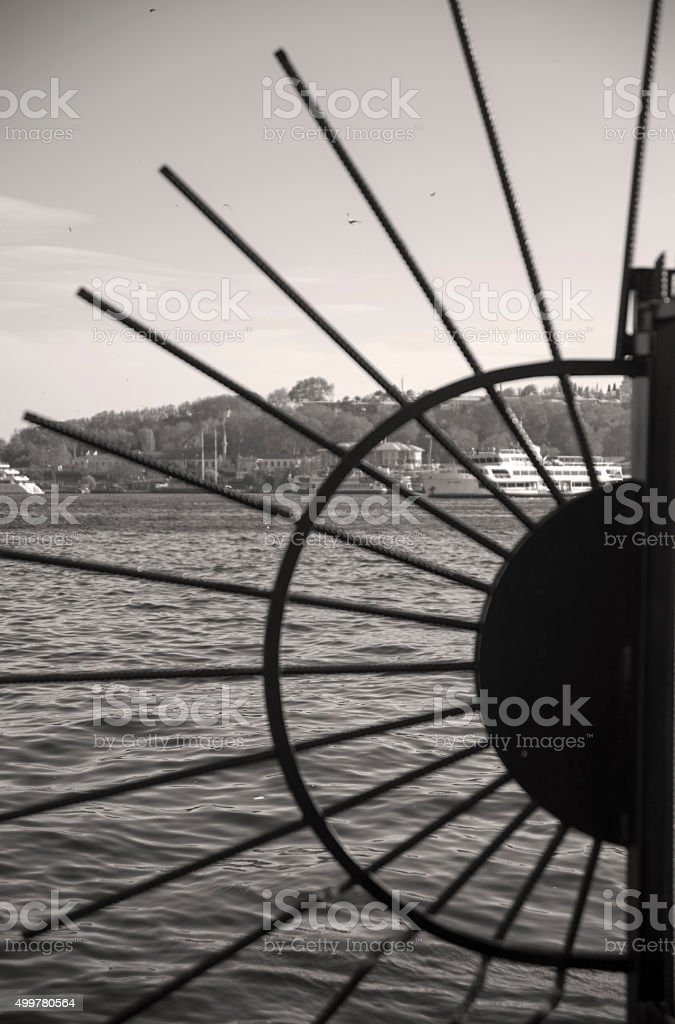 Barbed Wire and Sea -Black and white stock photo
