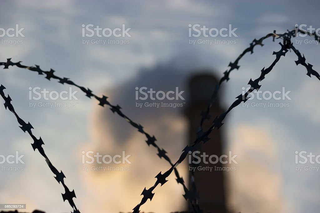 Barbed wire, factory pipe stock photo