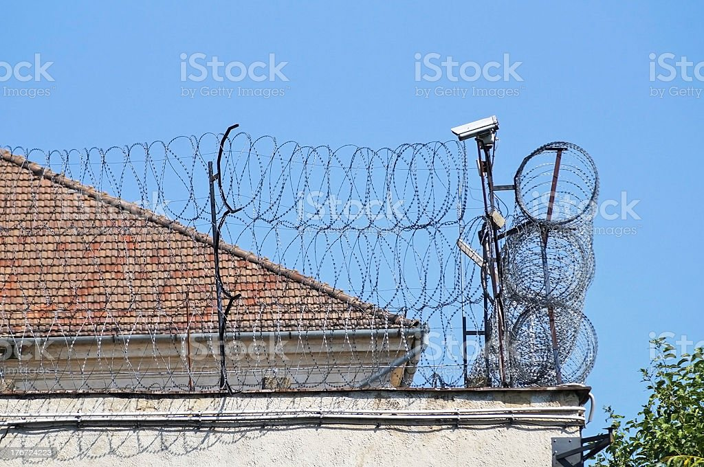 barbed wire fence of the prison royalty-free stock photo