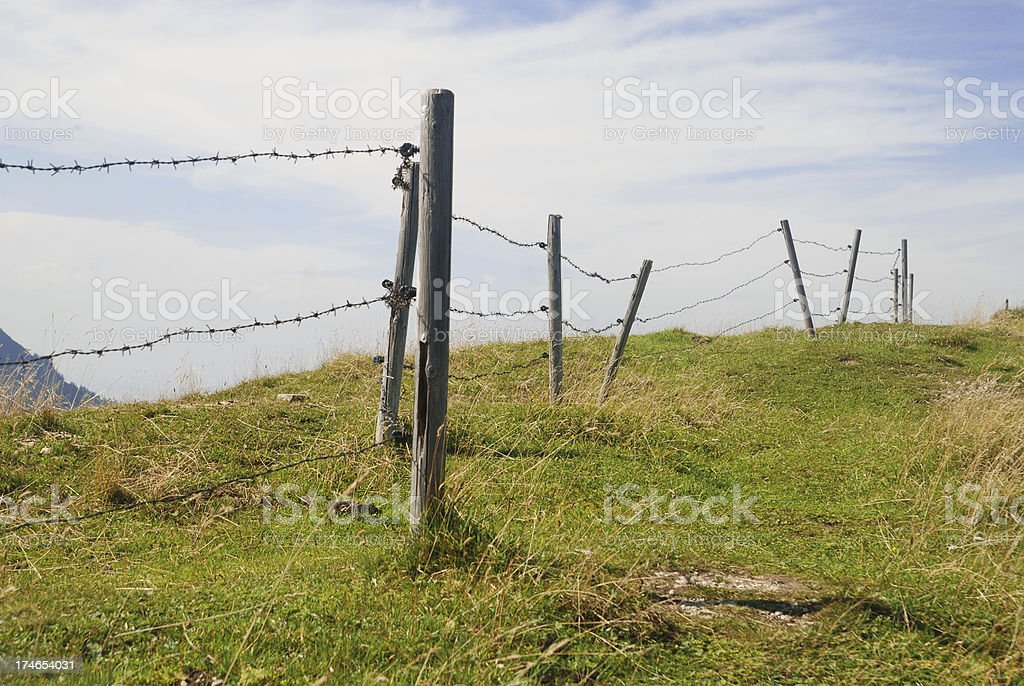barbed wire fence on alp - Stacheldrahtzaun auf Weide royalty-free stock photo