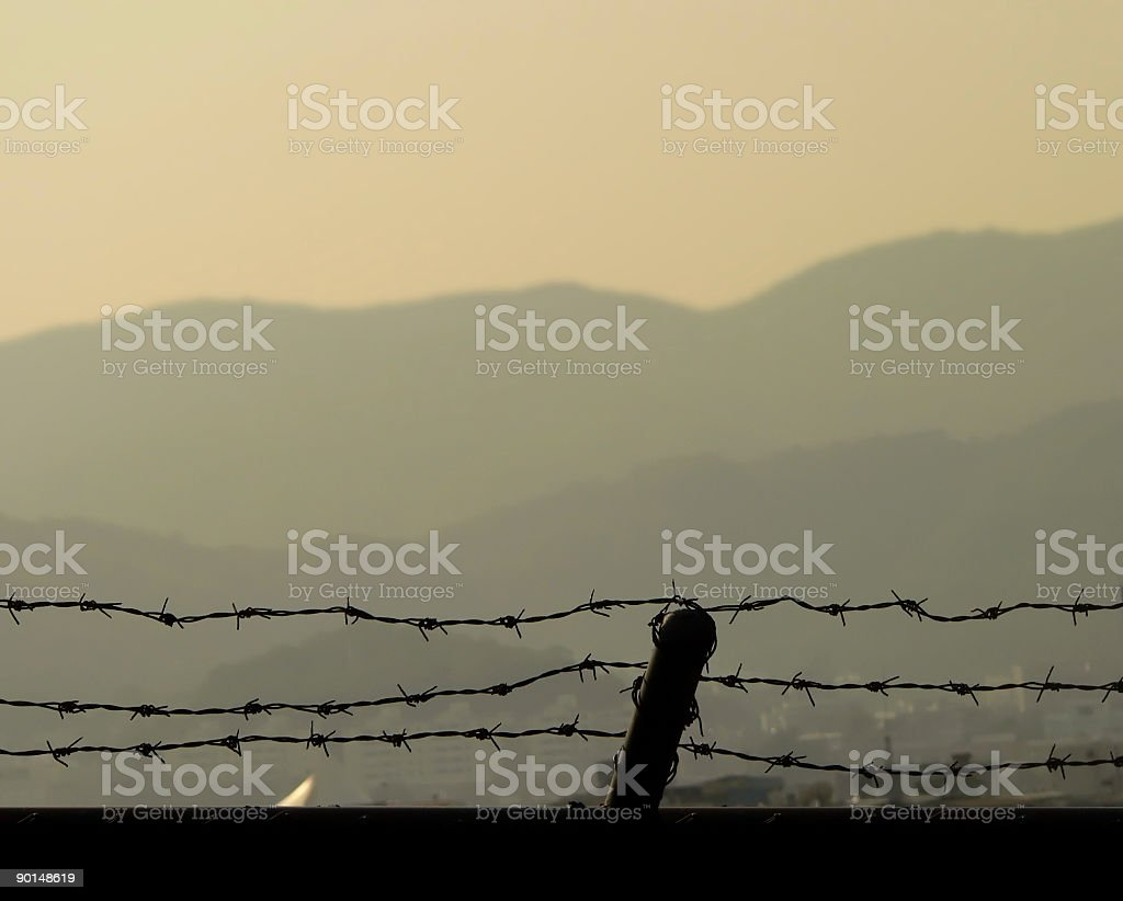 Barbed wire Fence with view to mountains and Freedom stock photo