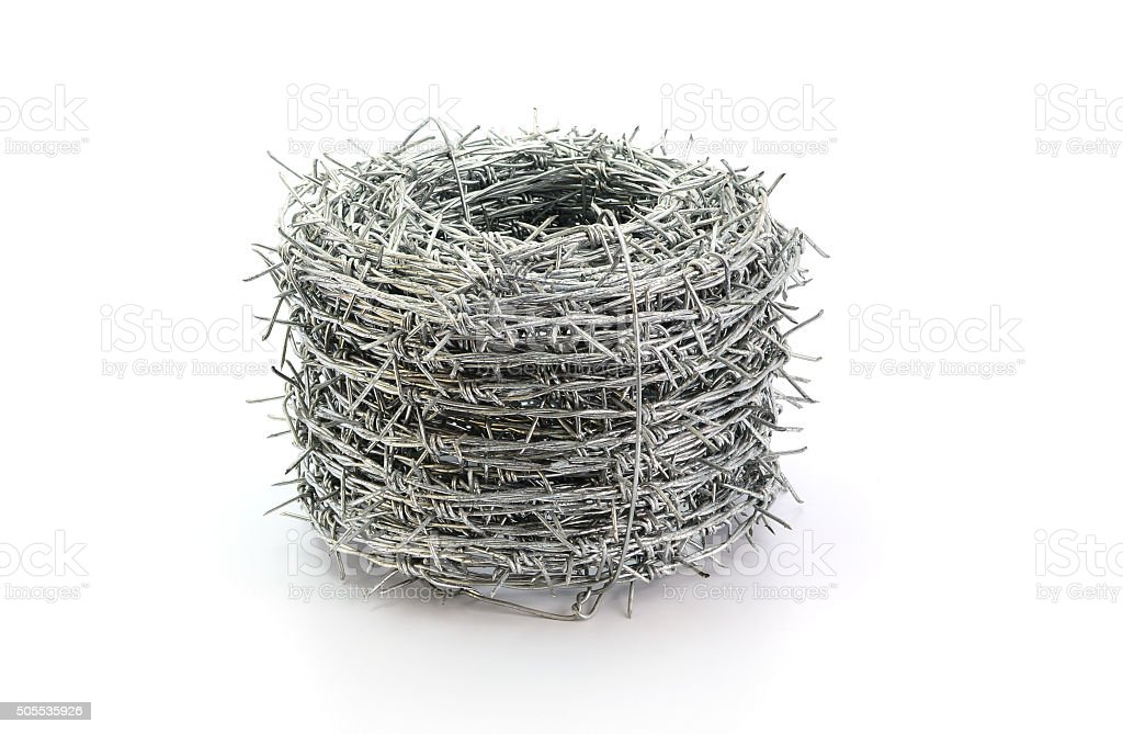 barbed wire roll isolated on white background stock photo