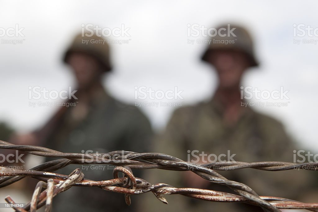 Barbed wire troops royalty-free stock photo