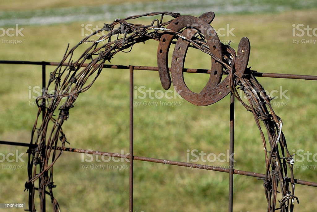 Barbed Wire Weath on Fence royalty-free stock photo