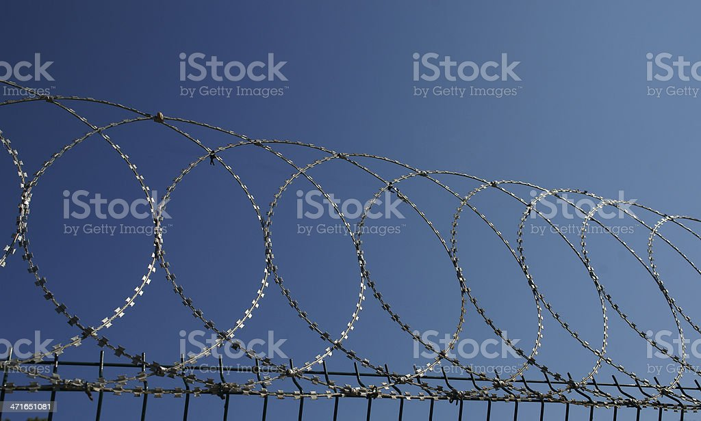 barbed-wire barrier stock photo