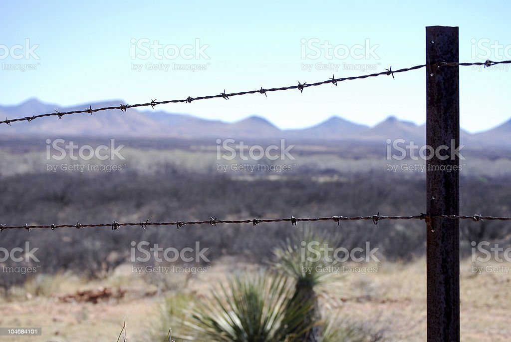 Barbed-wire fence at Mexico border stock photo