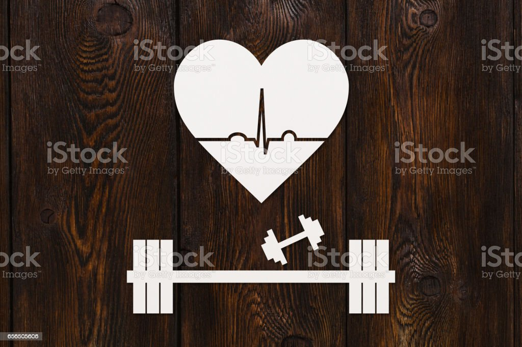 Barbell, dumbbells and heart with echocardiogram. Healthy lifestyle concept stock photo