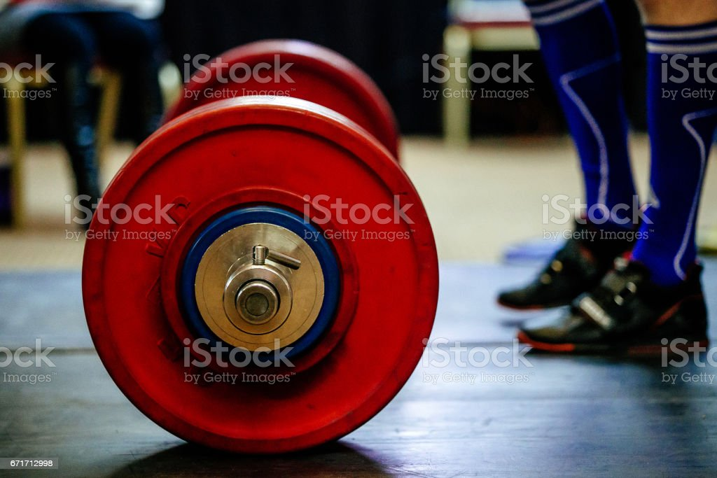 barbell for deadlift and foot athlete powerlifter competitions in powerlifting stock photo