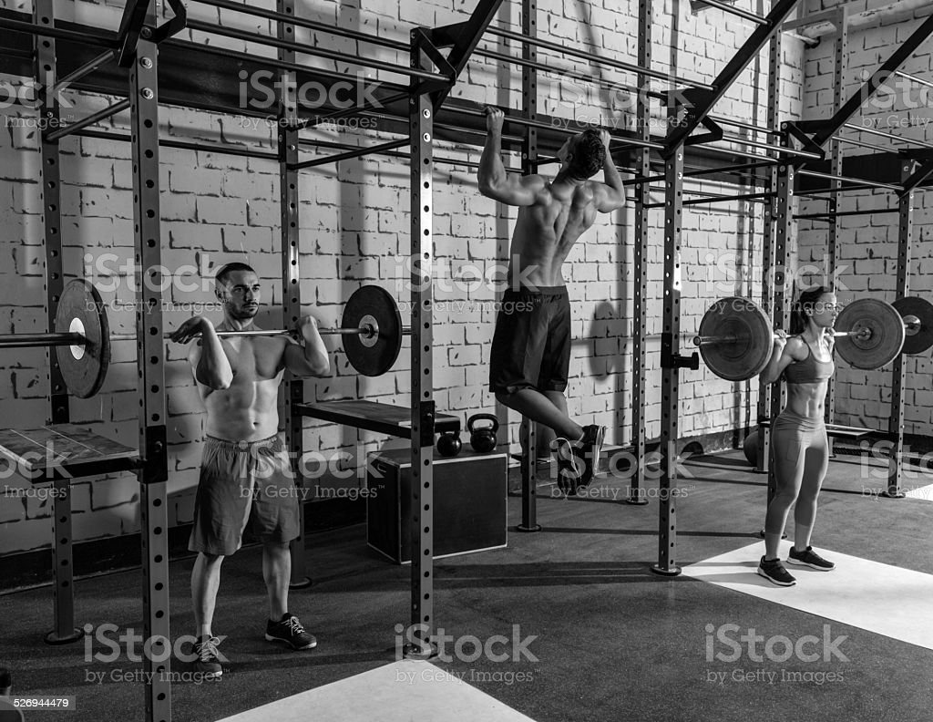 Barbell weight lifting group weightlifting at gym stock photo