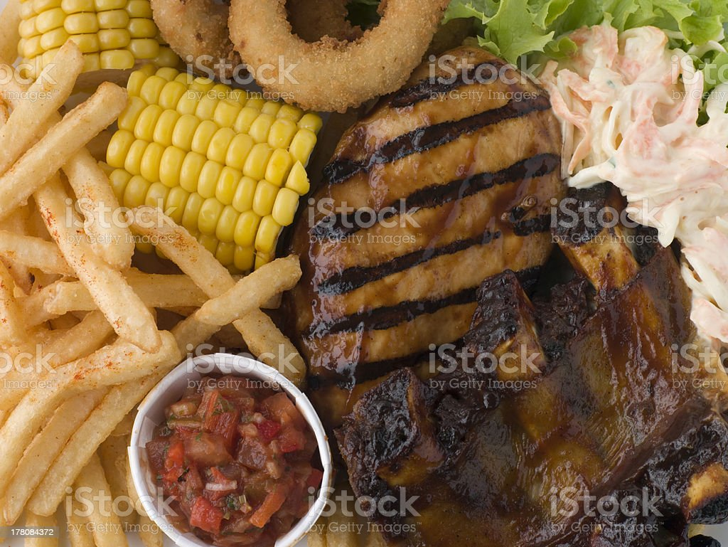 Barbeque Chicken and Ribs with Fries royalty-free stock photo