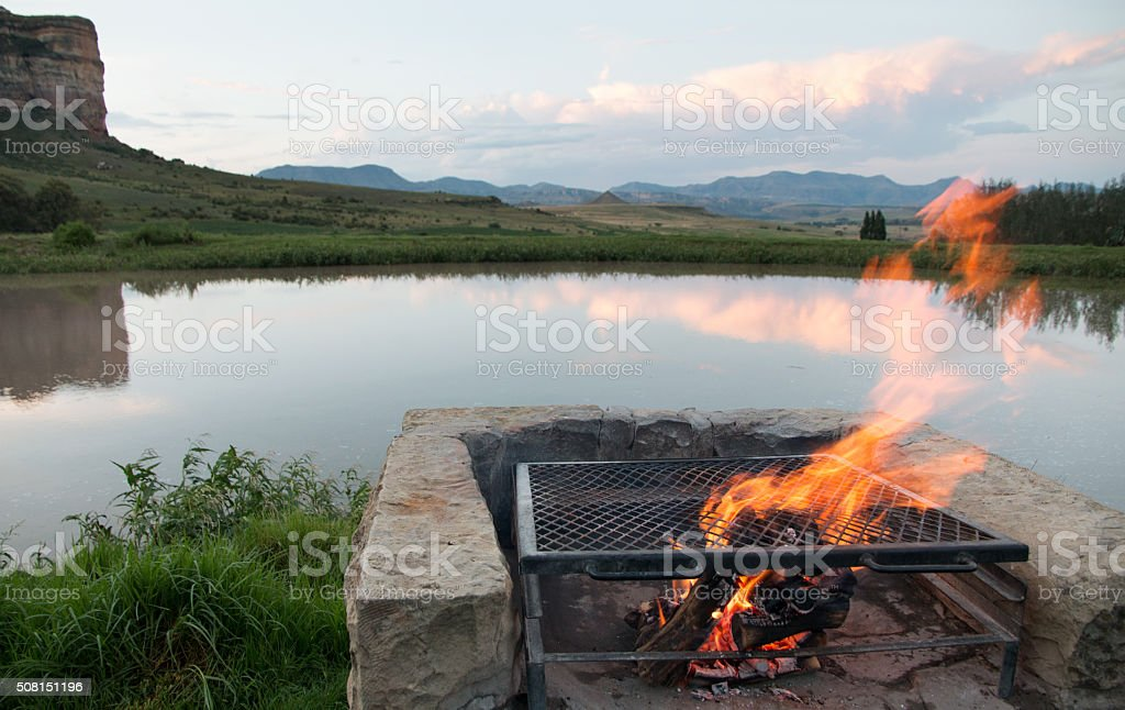 Barbeque fire and dam in typical Free State scene 3 stock photo