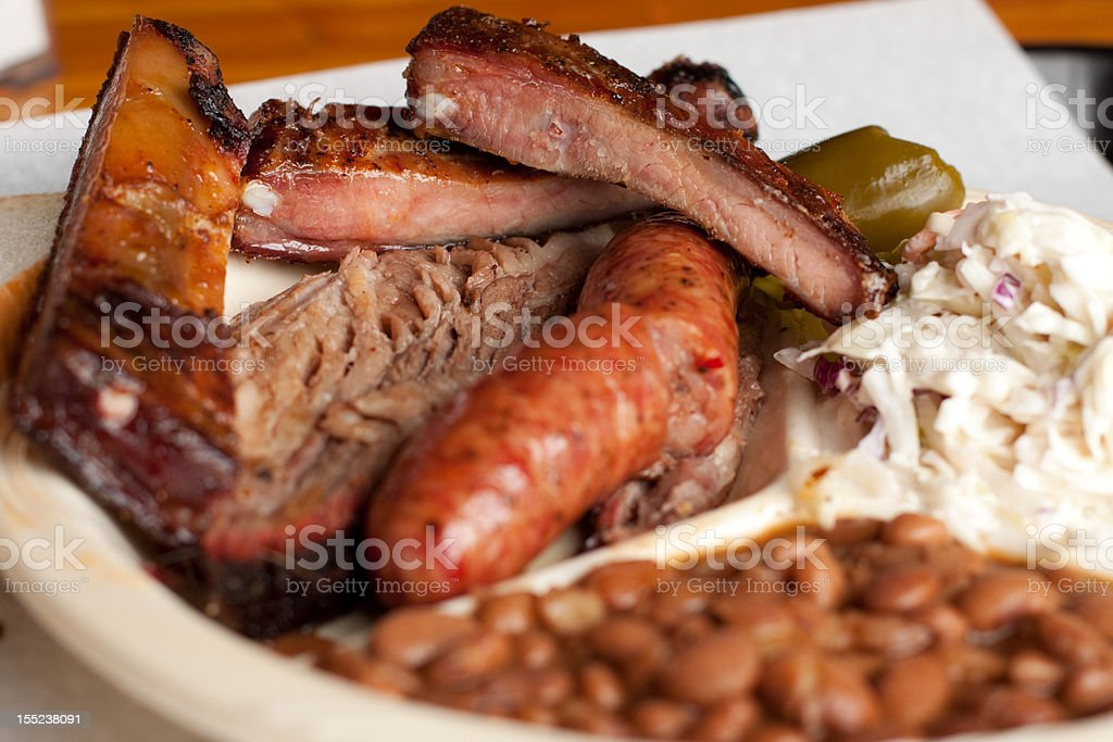 Barbeque plate with beef brisket, pork ribs and sausage stock photo