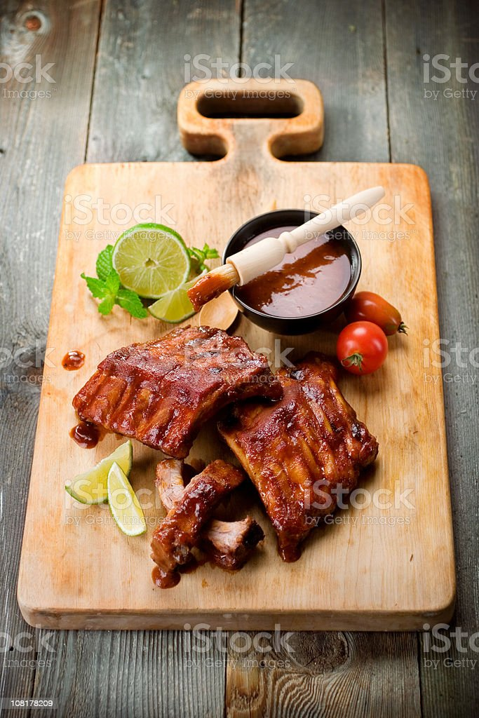 Barbeque Ribs on Cutting Board stock photo