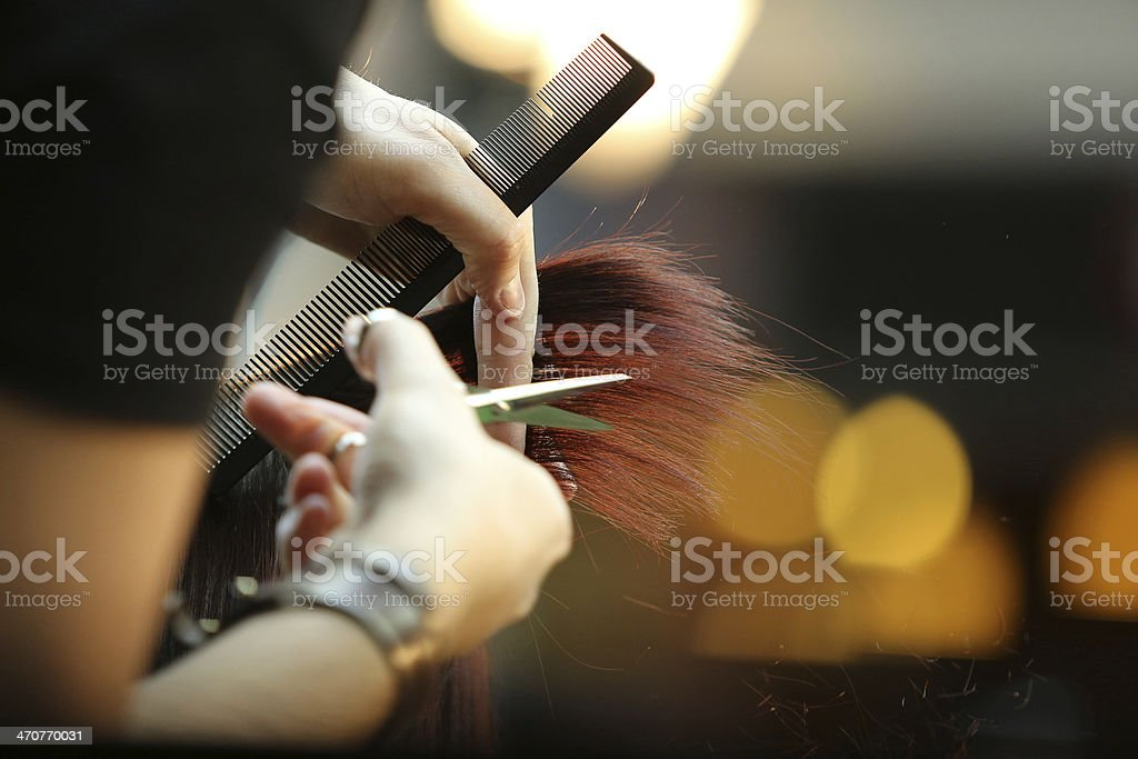 Barber cutting brown hair stock photo