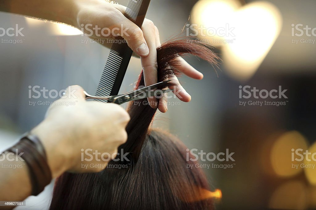 Barber cutting hair royalty-free stock photo