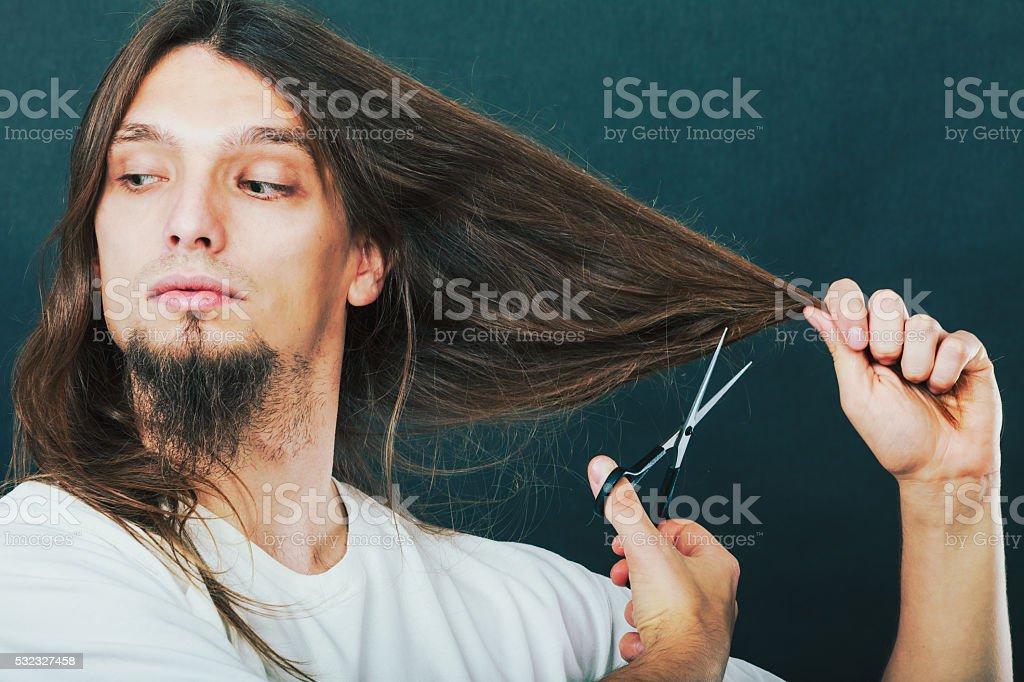 Barber cutting hair stock photo