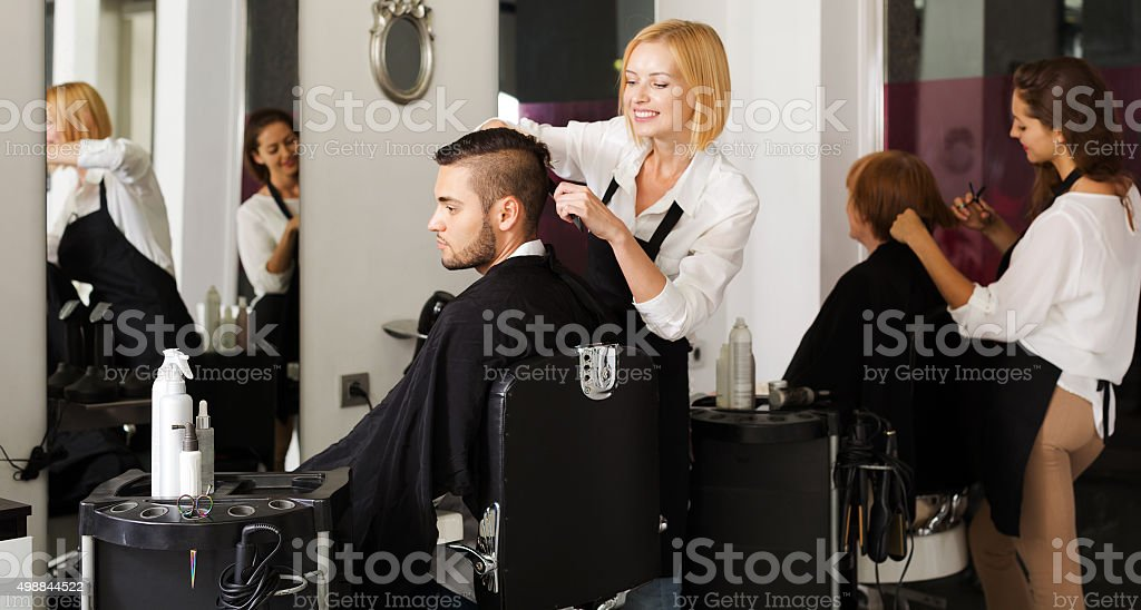 Barber makes the cut for man stock photo