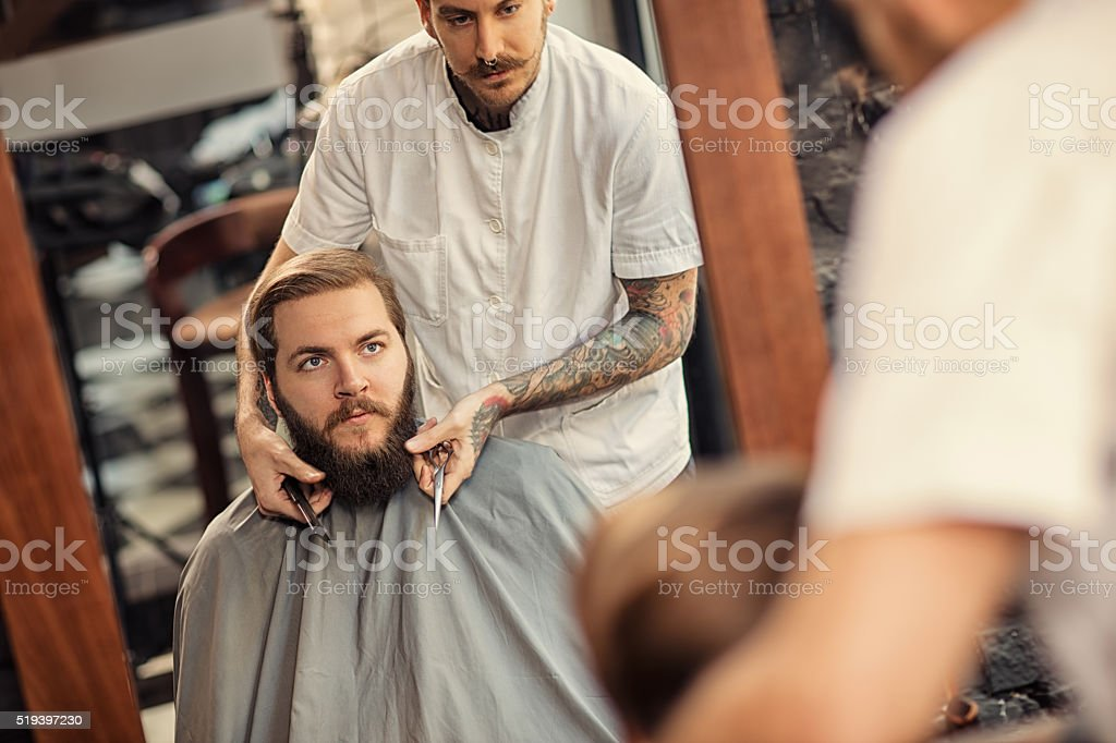 Barber man grooming of real hipster stock photo
