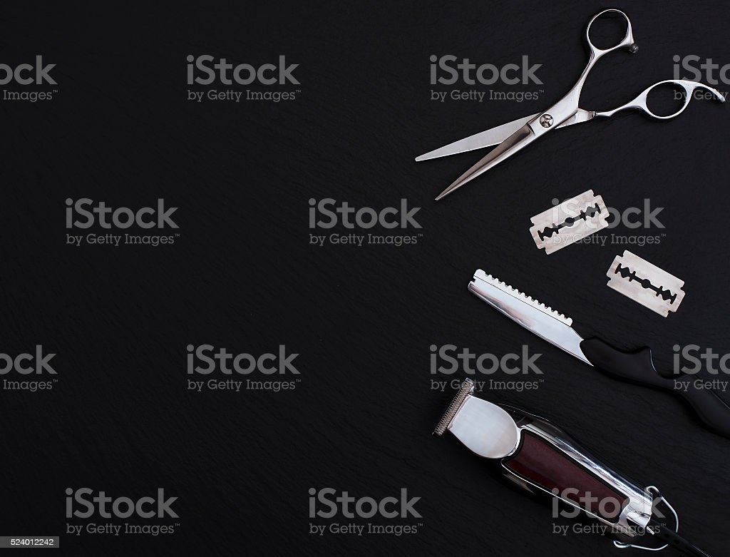 Barber shop tools on Black with place for text. stock photo