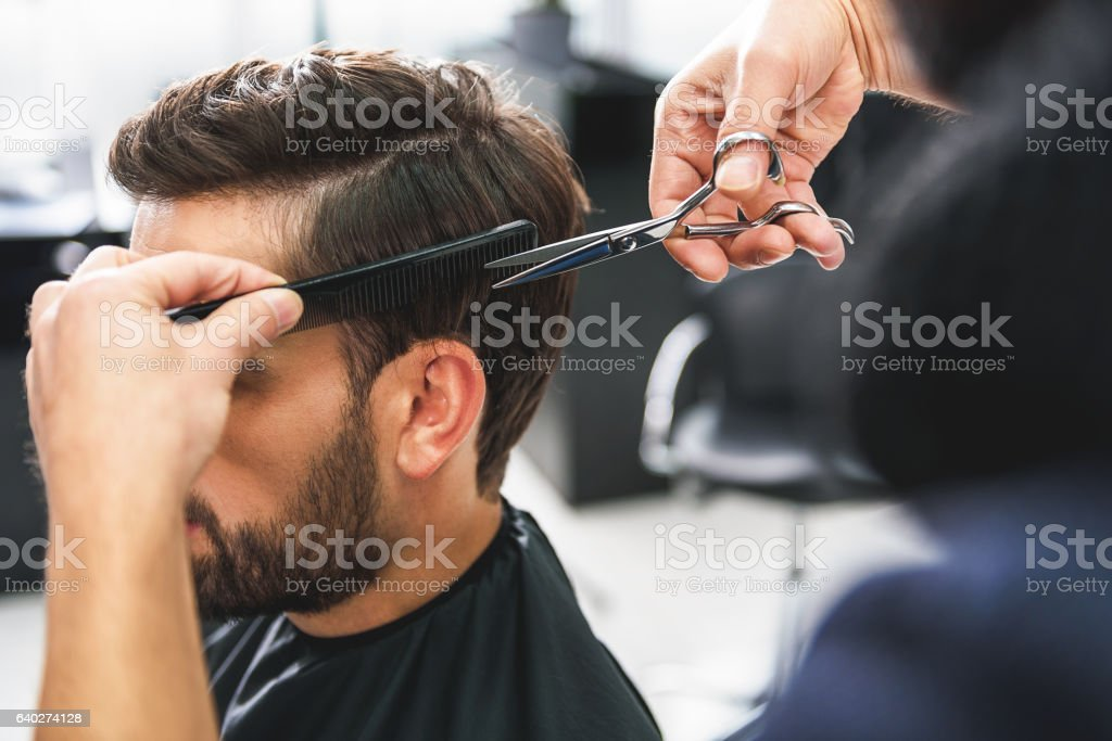 Barber using scissors and comb stock photo