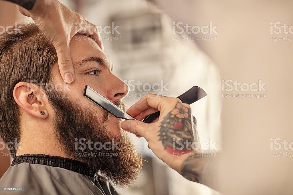 Barber with old-fashioned black razor stock photo