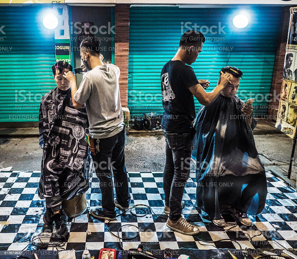 Barbers working on the street in Patpong Bangkok Thailand stock photo