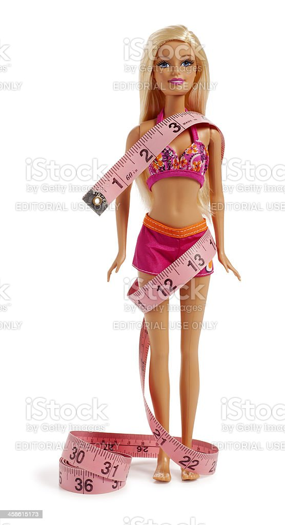Barbie Doll in a Bikini Wrapped with Tape Measure stock photo